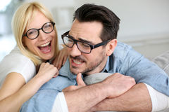 Funny couple at home Stock Photography