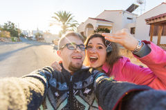 Funny couple With Keys Standing Outside New Home. Real estate, owner and people concept Royalty Free Stock Photo