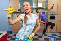 Funny couple on kitchen Royalty Free Stock Photos