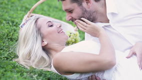 Funny couple on lawn stock video footage