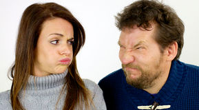 Funny couple looking at each other making funny faces Royalty Free Stock Photos