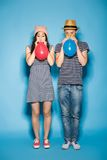 Funny couple in love with balls  the studio Royalty Free Stock Photos