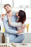 Funny Couple in love cooking dough and having fun with flour in  kitchen Royalty Free Stock Image