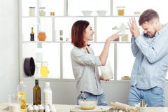 Funny Couple in love cooking dough and having fun with flour in  kitchen Royalty Free Stock Photography