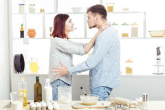 Funny Couple in love cooking dough and having fun with flour in  kitchen Stock Photo