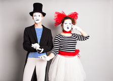 Funny couple of mimes talking by the phones. Concept of  April Fools Day. Funny couple of mimes talking by the phones. Concept of  April Fools Day Stock Images