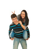 Funny couple in piggy back Royalty Free Stock Photo