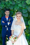 Funny couple preparing for wedding. Funny bride and groom on a summer day in the park Stock Image