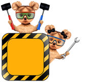 Funny couple of puppies with tools holding construction warning sign. Funny couple of puppies with protective goggles, hammer, wrench holding construction Stock Image