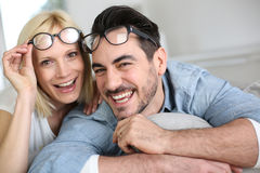 Funny couple removing eyeglasses Stock Photos