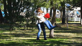 Funny couple running in a park stock footage