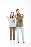 Funny couple showing thumbs up Stock Photo