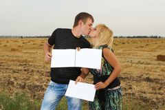 Funny Couple  shows blank piece of paper Stock Photography