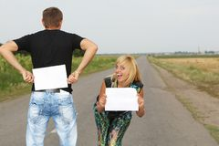 Funny Couple  shows blank piece of paper Stock Photo