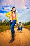 Funny couple are sledding at summer Royalty Free Stock Images