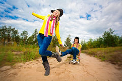 Funny couple are sledding at summer Royalty Free Stock Photography