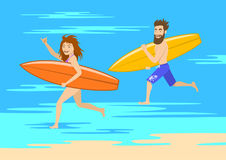 Funny couple surfers, man and woman running on the beach Royalty Free Stock Photography