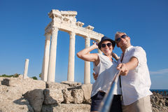 Funny couple take self photo near the antiuque sight Stock Images