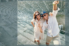 Funny couple take a selfie photo in antique amphitheatre in Side Royalty Free Stock Photo