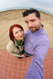 Funny couple taking fisheye selfie Royalty Free Stock Photography