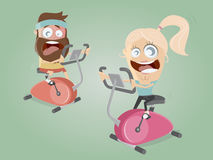 Funny couple training on indoor bike trainer Royalty Free Stock Photography