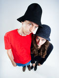 Funny couple wearing peasant hats Royalty Free Stock Image