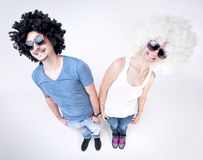 Funny couple wearing wigs smiling large Royalty Free Stock Image
