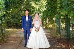 Funny couple, wedding photography. Funny bride and groom on a summer day in the park Royalty Free Stock Image