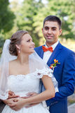 Funny couple, wedding photography. Funny bride and groom on a summer day in the park Stock Photos