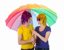 Funny couple with wigs, sunglasses and umbrellas Royalty Free Stock Photo