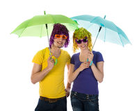 Funny couple with wigs, sunglasses and umbrellas Royalty Free Stock Photography