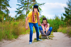 Funny couplel are sledding at summer Royalty Free Stock Photo