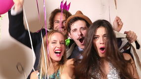 Funny couples playing with props in party photo booth stock footage