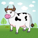 Funny cow standing in a meadow Stock Image