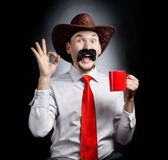 Funny Cowboy with cup Stock Photography
