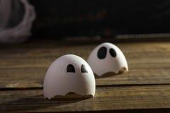 Funny cracked hen eggshell Stock Photos