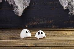 Funny cracked hen eggshell Stock Images