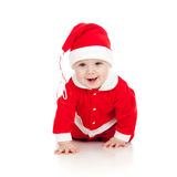 Funny crawling Santa claus baby boy. On white background royalty free stock images
