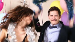 Funny crazy couple dancing. In photo booth stock video footage