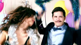 Funny crazy couple dancing. In photo booth, graded stock footage