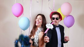 Funny crazy couple having awesome time dancing. In party photo booth stock video