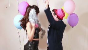 Funny crazy couple having awesome time dancing. In party photo booth stock footage