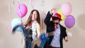 Funny crazy couple having awesome time dancing. In party photo booth stock video footage