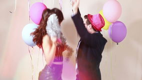 Funny crazy couple having awesome time dancing. In party photo booth, graded stock footage