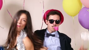 Funny crazy couple having fun in photo booth stock video footage