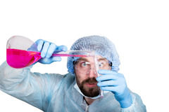 Funny crazy emotional chemist with flask. mad scientist in his laboratory experimenting on secret formulas. Royalty Free Stock Images