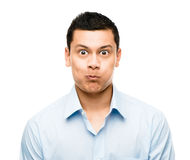Funny crazy face man mixed race latino Stock Images