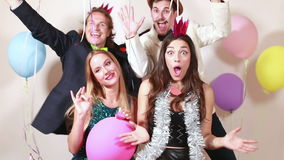 Funny crazy friends in photo booth stock video footage