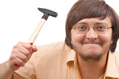 Funny crazy guy with a hammer Royalty Free Stock Photo