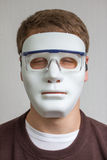 Funny and crazy guy with plain white mask. A funny and crazy guy with plain white mask Stock Photos